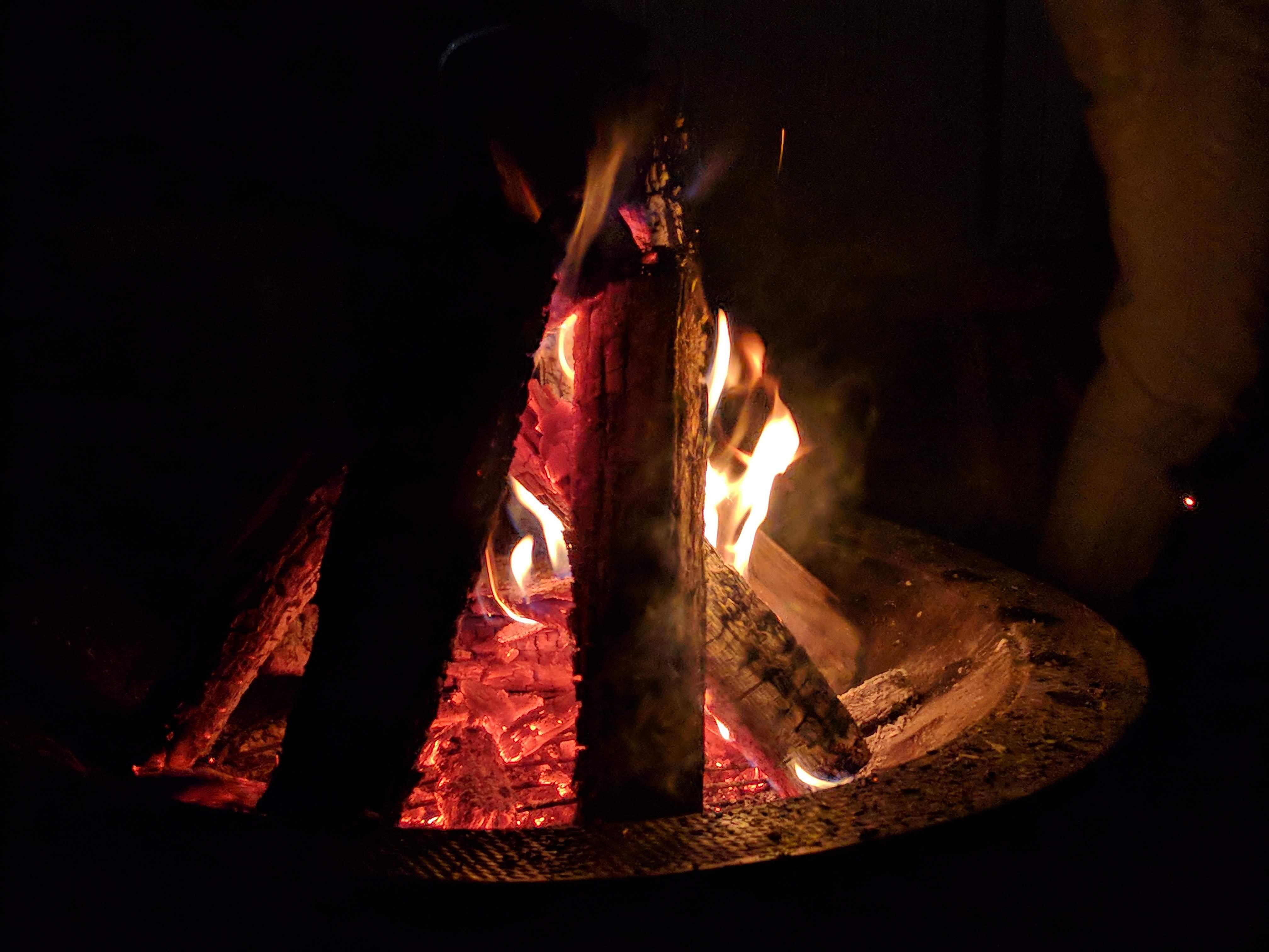 logs on fire in firepit